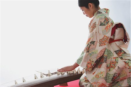 string - Japanese woman in a kimono playing the koto Stock Photo - Rights-Managed, Code: 859-06405009