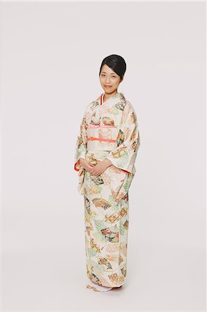 Japanese woman in a kimono looking at camera Stock Photo - Rights-Managed, Code: 859-06405003