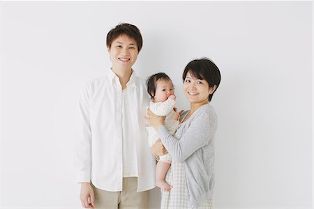 Young adult couple and son smiling at camera Stock Photo - Rights-Managed, Code: 859-06469766