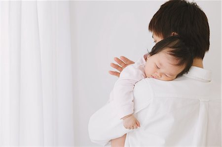 Baby boy sleeping on his fathers shoulder Stock Photo - Rights-Managed, Code: 859-06469772