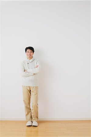 Mature adult man standing in front of a white wall with crossed arms Stock Photo - Rights-Managed, Code: 859-06469853