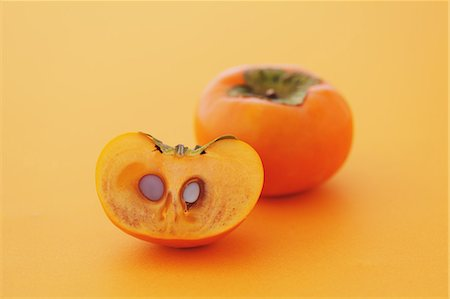 delicious - Japanese Persimmons on orange background Stock Photo - Rights-Managed, Code: 859-06470137