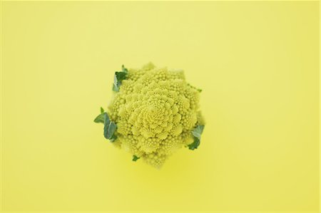delicious - Romanesco Broccoli on yellow background Stock Photo - Rights-Managed, Code: 859-06470258