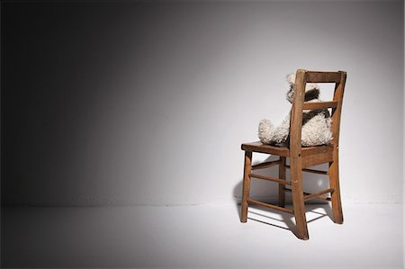 Teddy bear on a chair against a wall Stock Photo - Rights-Managed, Code: 859-06537699