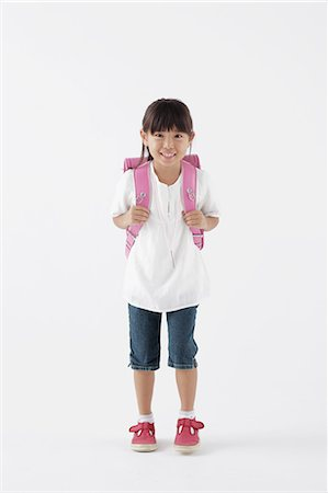 Girl carrying a school bag Stock Photo - Rights-Managed, Code: 859-06537718