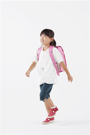 Girl carrying a school bag Stock Photo - Rights-Managed, Code: 859-06537719