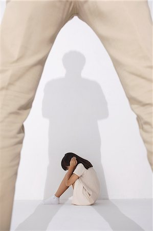 Girl in a white dress sitting scared on the floor Stock Photo - Rights-Managed, Code: 859-06537712