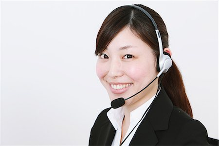 switchboard operator - Businesswoman with headset Stock Photo - Rights-Managed, Code: 859-06537887