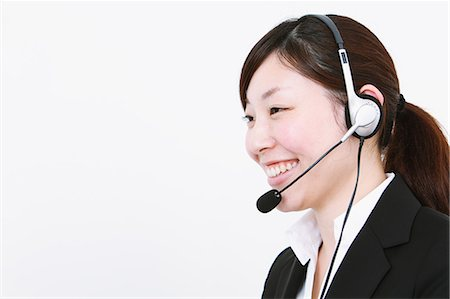 switchboard operator - Businesswoman with headset Stock Photo - Rights-Managed, Code: 859-06537889