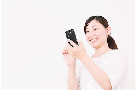 Woman using Smartphone Stock Photo - Rights-Managed, Code: 859-06537897