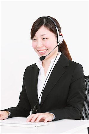 switchboard operator - Businesswoman with headset Stock Photo - Rights-Managed, Code: 859-06537890