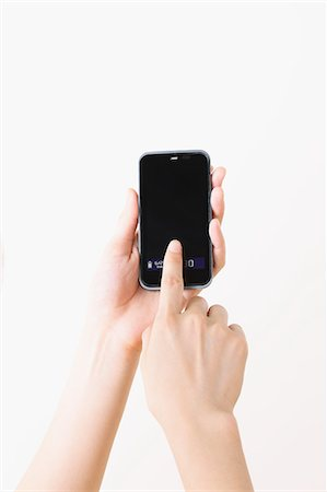fingers holding - Using a Smartphone Stock Photo - Rights-Managed, Code: 859-06537904