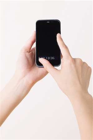 fingers holding - Using a Smartphone Stock Photo - Rights-Managed, Code: 859-06537905