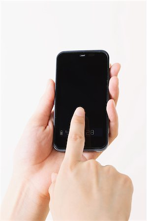 fingers holding - Using a Smartphone Stock Photo - Rights-Managed, Code: 859-06537903