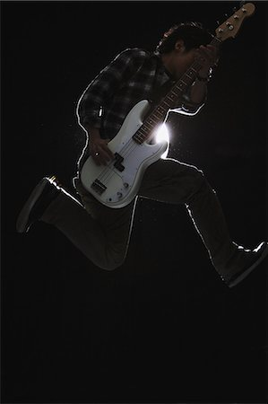 Guitarist jumping Stock Photo - Rights-Managed, Code: 859-06537950