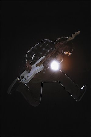 Guitarist jumping Stock Photo - Rights-Managed, Code: 859-06537951