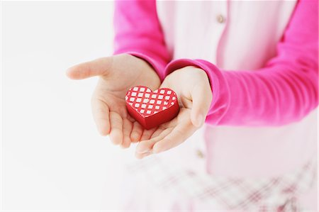Young girl holding heart accessory Stock Photo - Rights-Managed, Code: 859-06537973