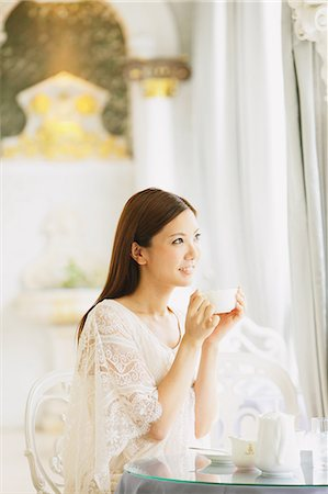 Young woman relaxing in a cafe Stock Photo - Rights-Managed, Code: 859-06538086