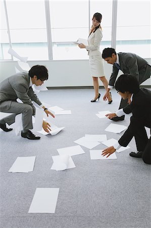 people in panic - Business people picking up papers Stock Photo - Rights-Managed, Code: 859-06538173