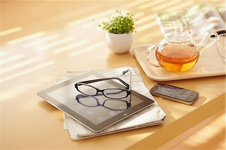 Tea tablet and newspapers on a table Stock Photo - Rights-Managed, Code: 859-06538441