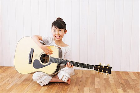 Girl Playing the Guitar Stock Photo - Rights-Managed, Code: 859-06617256