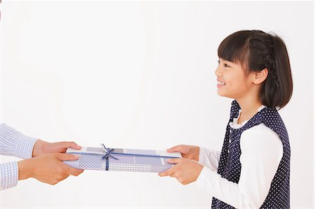 Daughter Giving a Present To Her Father Stock Photo - Rights-Managed, Code: 859-06617363