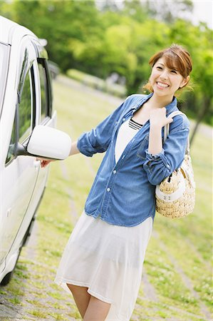Woman Smiling With Car Stock Photo - Rights-Managed, Code: 859-06617474