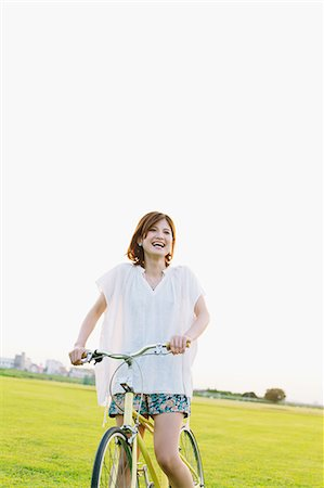 Woman Riding a Bicycle Stock Photo - Rights-Managed, Code: 859-06617526