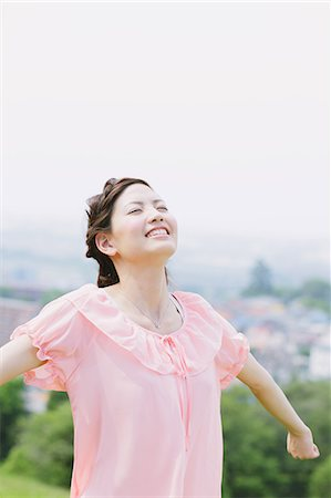Japanese woman smiling with closed eyes Stock Photo - Rights-Managed, Code: 859-06710940