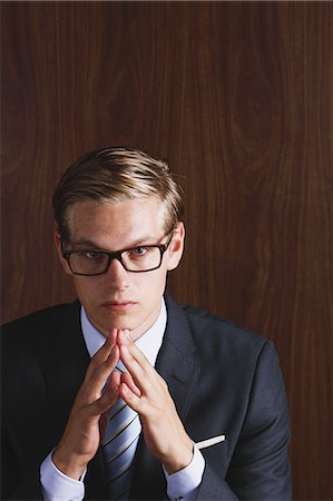 Businessman with glasses looking at camera Stock Photo - Rights-Managed, Code: 859-06711005