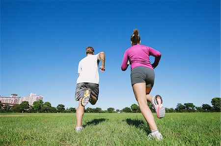 Couple running in a park Stock Photo - Rights-Managed, Code: 859-06711050