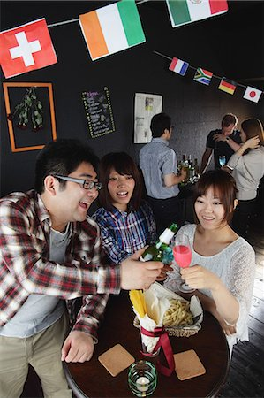 Young people having a drink in a bar Stock Photo - Rights-Managed, Code: 859-06711147