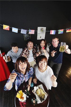 Young people cheering in a bar Stock Photo - Rights-Managed, Code: 859-06711148