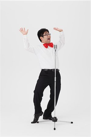 funny pose - Comedian performing Stock Photo - Rights-Managed, Code: 859-06711151