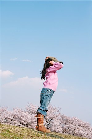 Young girl on grassland looking away Stock Photo - Rights-Managed, Code: 859-06808389