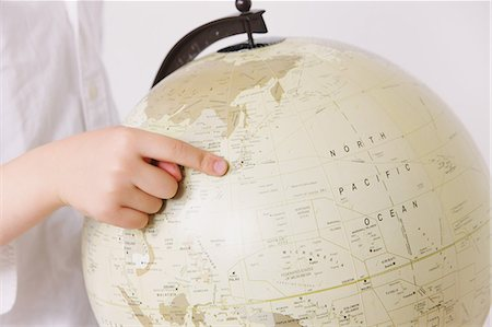 preteens fingering - Child pointing a finger on globe Stock Photo - Rights-Managed, Code: 859-06808669