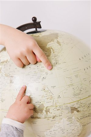 preteens fingering - Child pointing fingers on globe Stock Photo - Rights-Managed, Code: 859-06808670