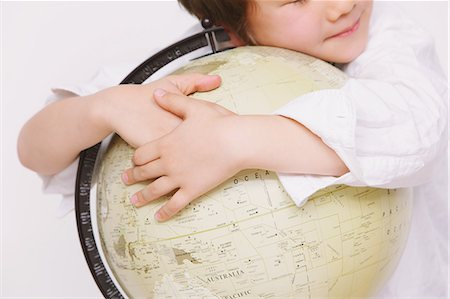 Children embracing globe Stock Photo - Rights-Managed, Code: 859-06808671