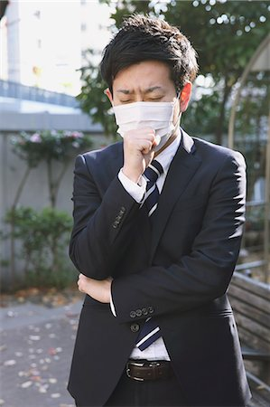 people coughing or sneezing - Sick Japanese young businessman in a suit at the park Stock Photo - Rights-Managed, Code: 859-07711103