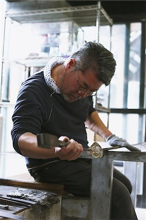 Japanese glass artisan working in the studio Stock Photo - Rights-Managed, Code: 859-08384709