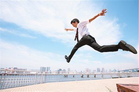 flying - Young Japanese businessman jumping Stock Photo - Rights-Managed, Code: 859-08704120