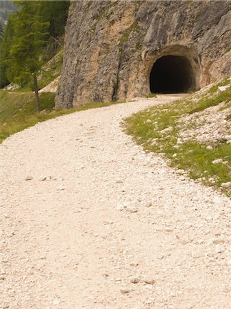 forward - Curving dirt road with tunnel Stock Photo - Rights-Managed, Code: 859-03036361