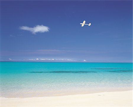 A Plane Flying Near The Coastline Stock Photo - Rights-Managed, Code: 859-03036472