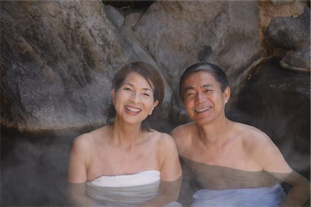Middle-aged couple relaxing in natural hot spring Stock Photo - Rights-Managed, Code: 859-03038559