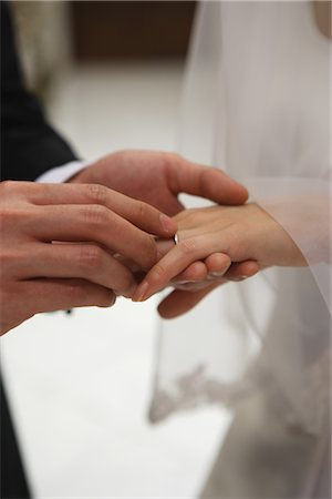 Groom Putting the Ring on his Brides finger Stock Photo - Rights-Managed, Code: 859-03039170
