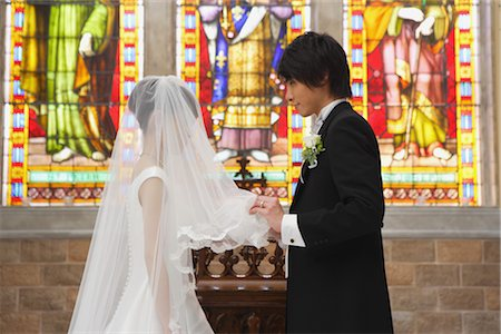 Groom Lifting Veil Stock Photo - Rights-Managed, Code: 859-03039173