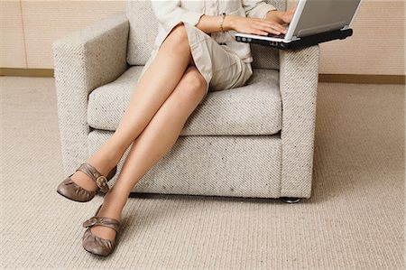 sexy women legs - Businesswoman Crossing Legs Stock Photo - Rights-Managed, Code: 859-03599391