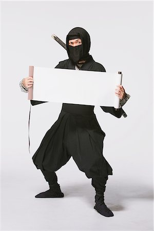 scroll (design) - Ninja Holding A Scroll Stock Photo - Rights-Managed, Code: 859-03730755