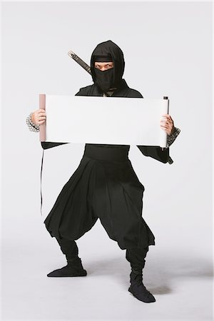 scroll (design) - Ninja Holding A Scroll Stock Photo - Rights-Managed, Code: 859-03730756