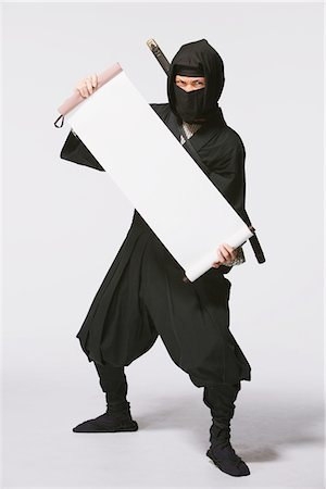 scroll (design) - Ninja Holding A Scroll Stock Photo - Rights-Managed, Code: 859-03730758